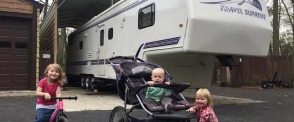 Kids And Trailer At Lake